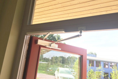 Back check and overhead door closer